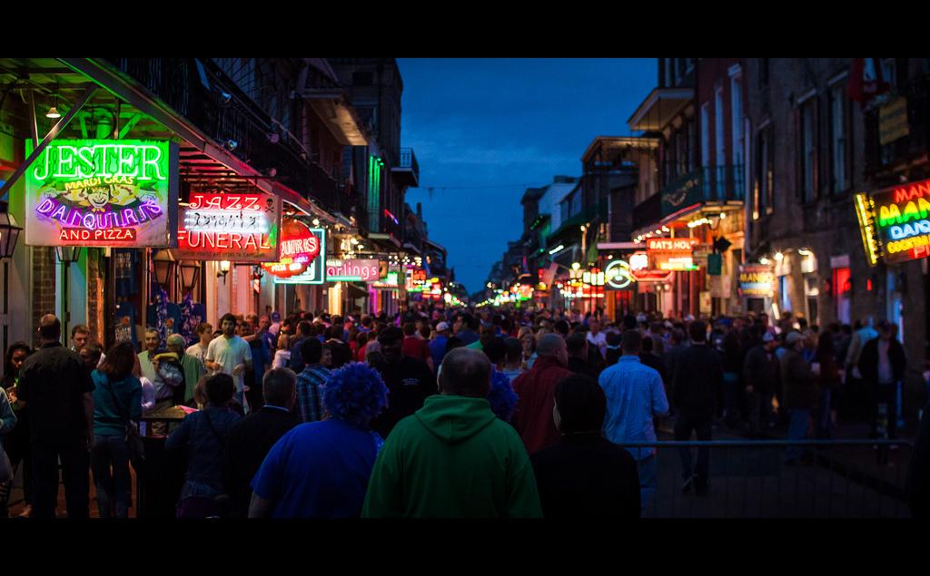 bourbon street crowd night new orleans