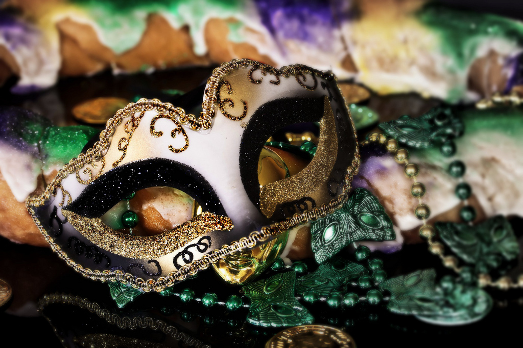 king cake and mardi gras mask new orleans